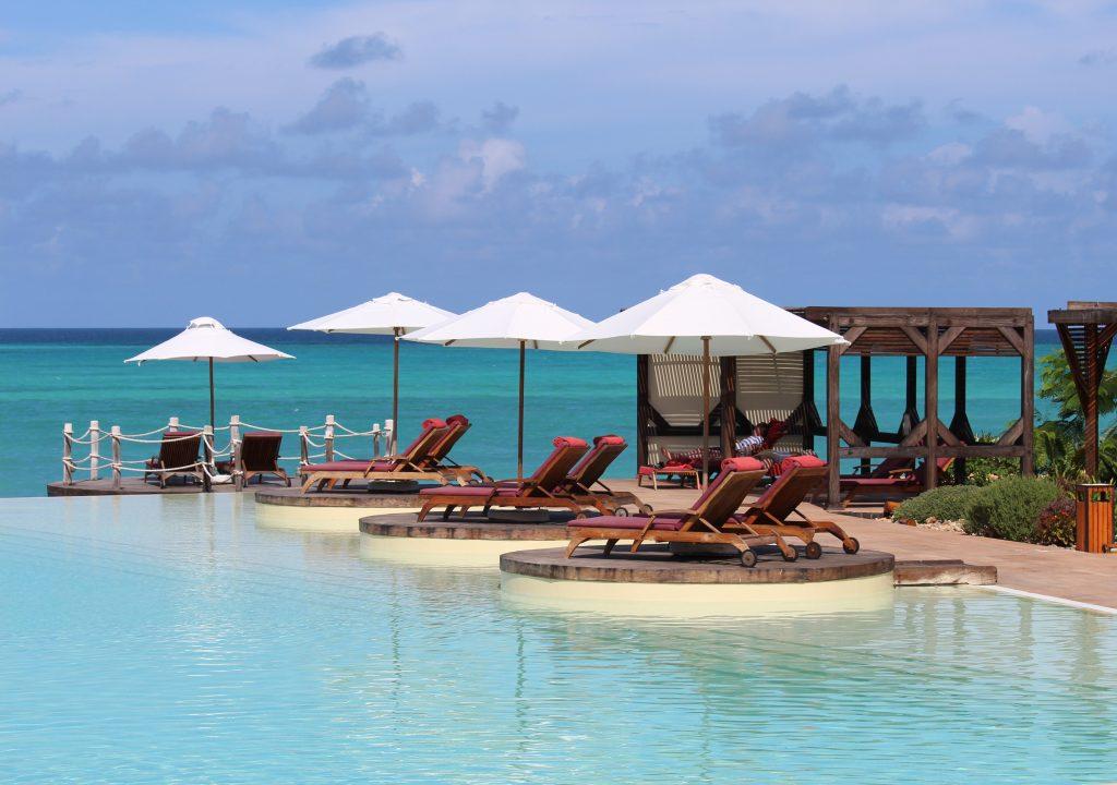Salt water infinity pool in Zanzibar Tanzania beach blue