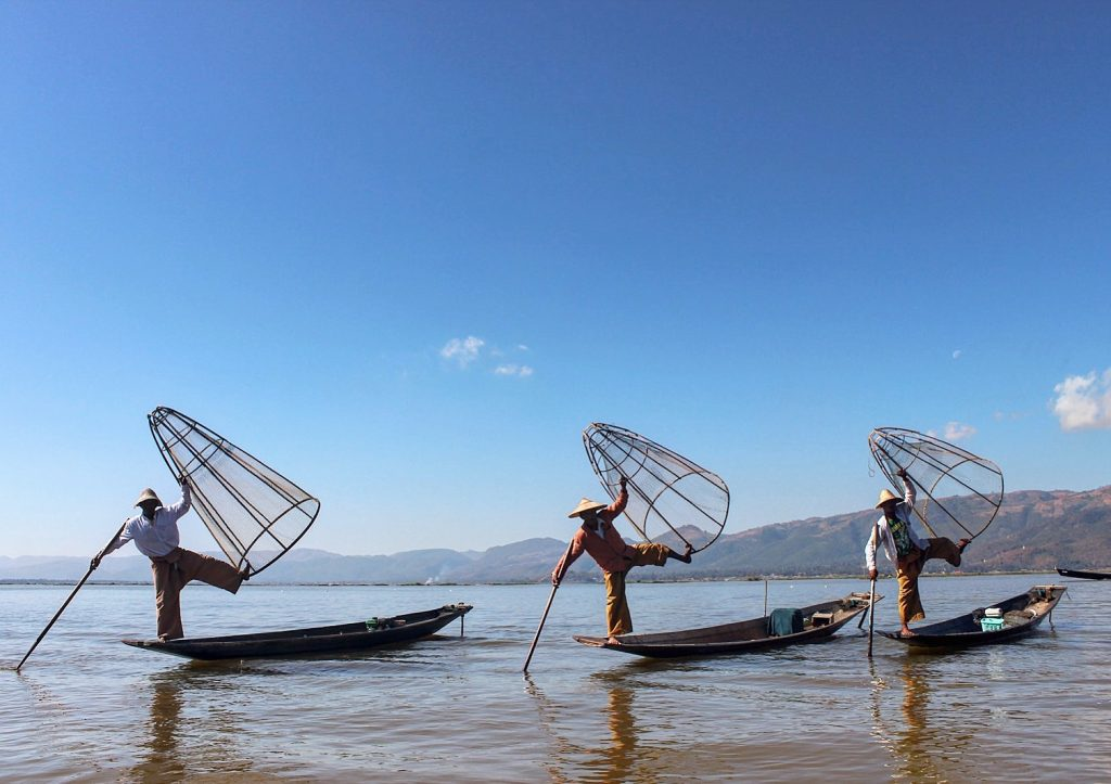 Leg rowing fishermen displaying their great balance in Inle Lake Myanmar Burma